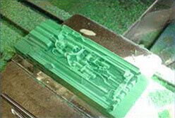 Tooling master model during the CNC machining process
