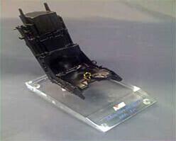 Painted vacuum cast polyurethane model mounted on a CNC engraved acrylic base